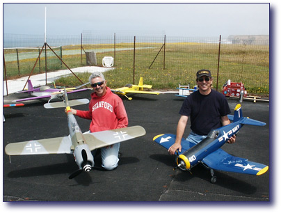 Jake and Ray hold their Warbirds